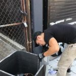 HVAC Service tech with ac condenser